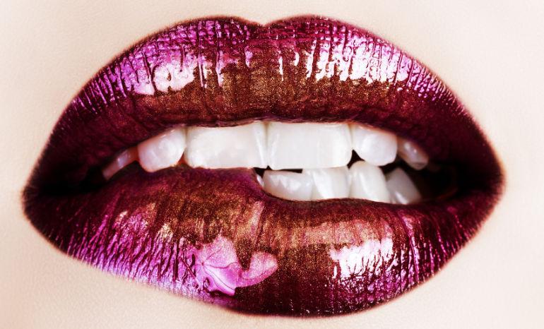 macro of beautiful lips with purple and gold lipstick