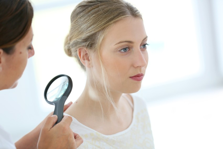 Young woman seeing doctor for dermatological control
